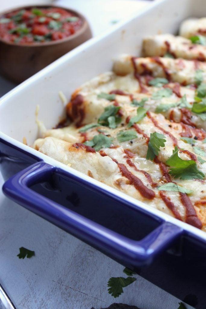 Chicken and Roasted Pepper Enchiladas with Creamy Cauliflower Sauce in Dish