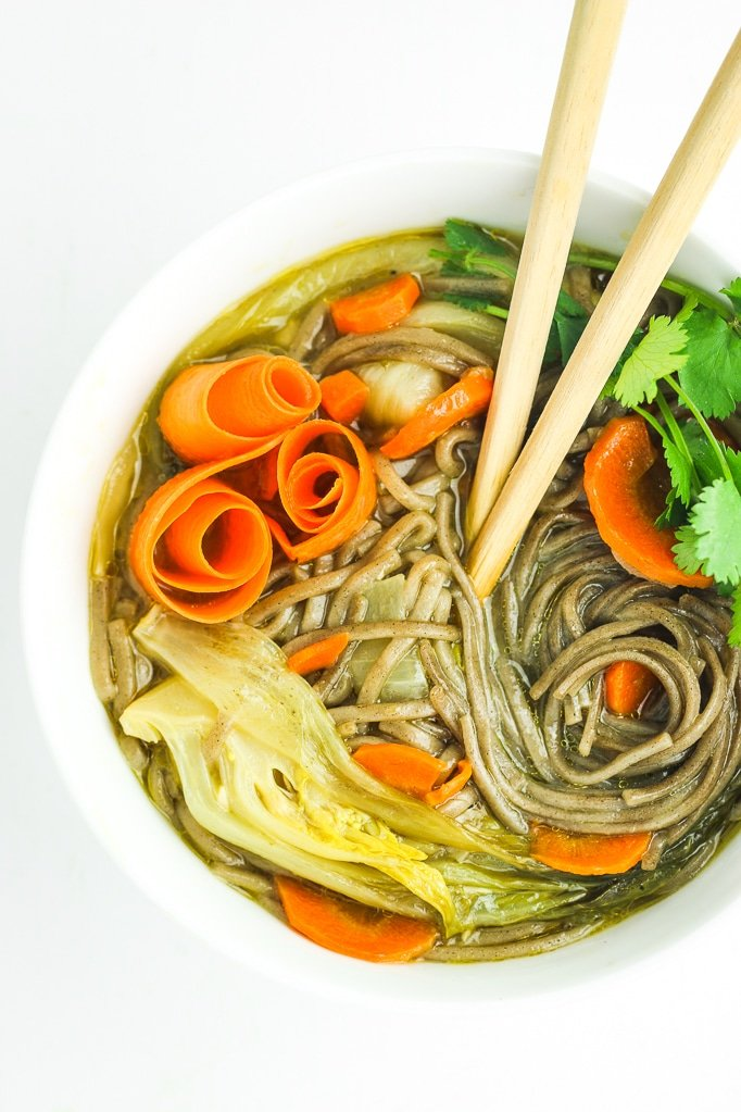 Asian Soba Noodle Soup in Bowl with Chopsticks
