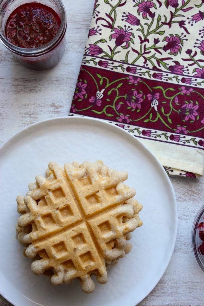 Vegan Gluten Free Waffles on plate with Raspberry Lemon Syrup