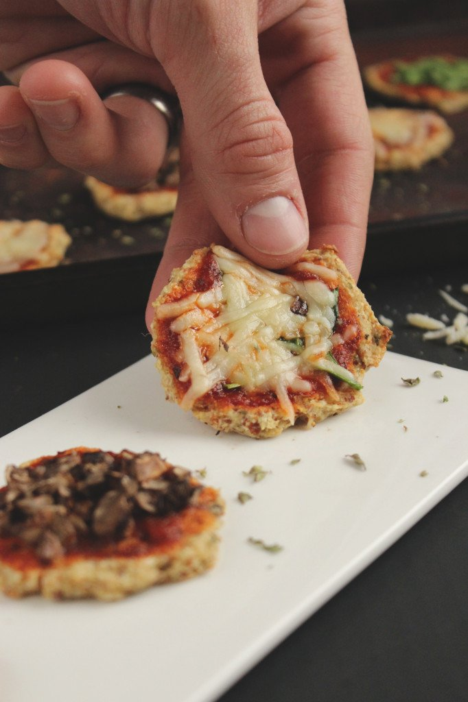 Hand Holding Mini Cauliflower Crust Pizza Bite