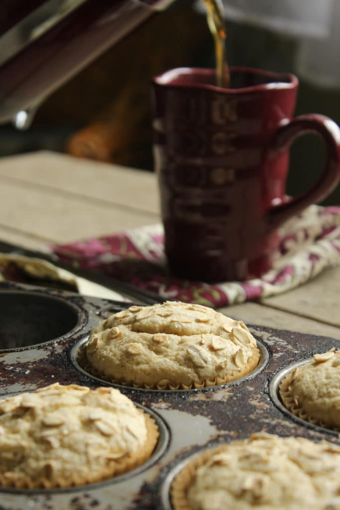 Gluten Free Muffins in Baking Tray Pouring Coffee into Mug
