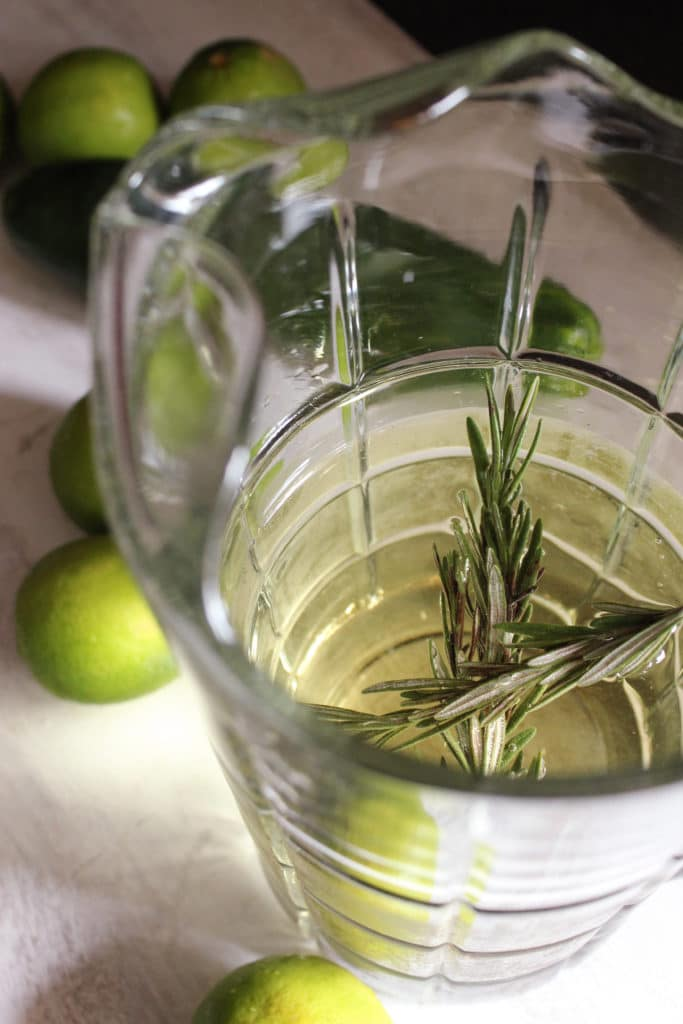Gin and Tonic Sangria in Jug Limes and Rosemary
