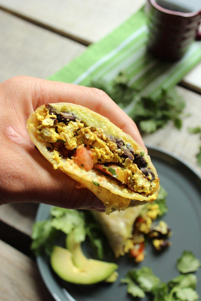 Hand Holding Healthy Tofu Breakfast Burritos