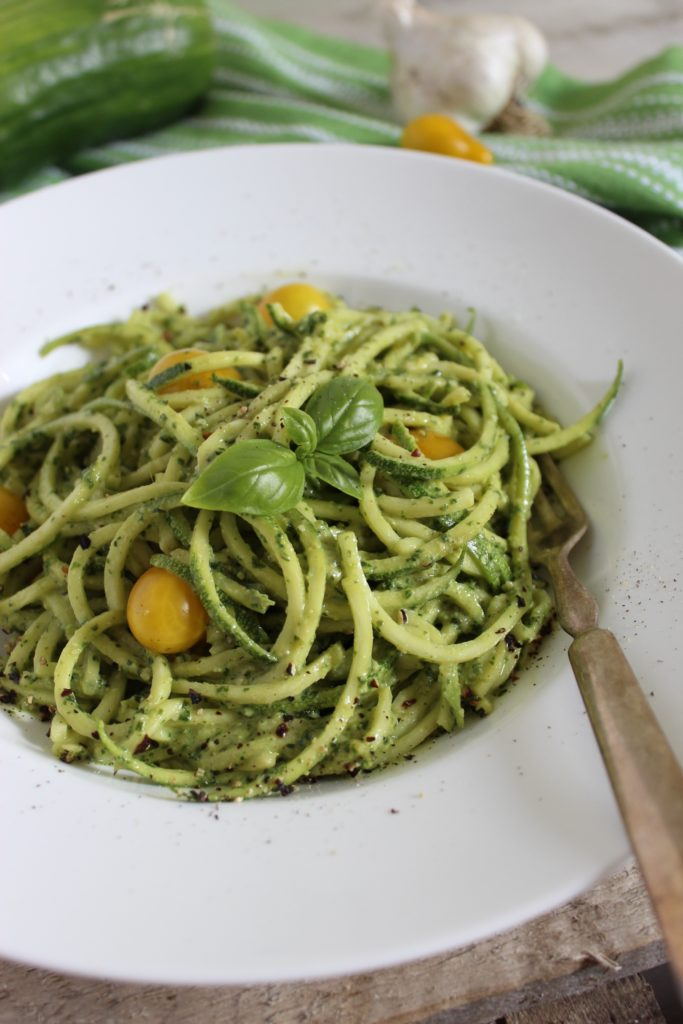 Zucchini Pasta with Vegan Cashew Basil Pesto with Fork in Bowl