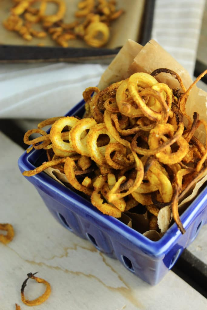 Indian Spiced Parsnip Curly Fries in Blue Bowl