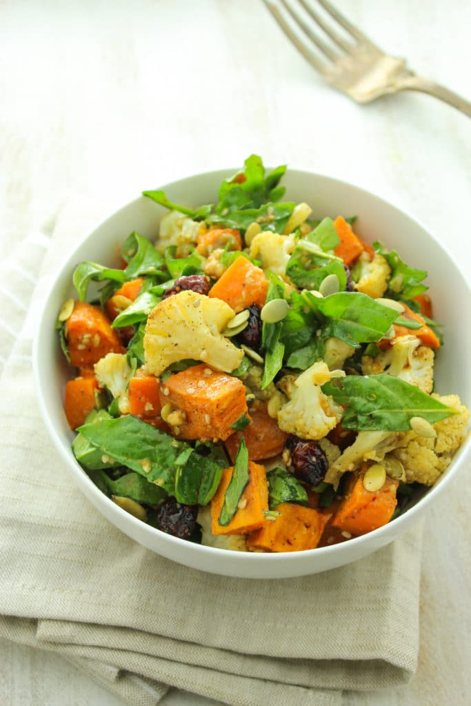 Roasted Sweet Potato Salad with Ginger Miso Dressing in bowl fork