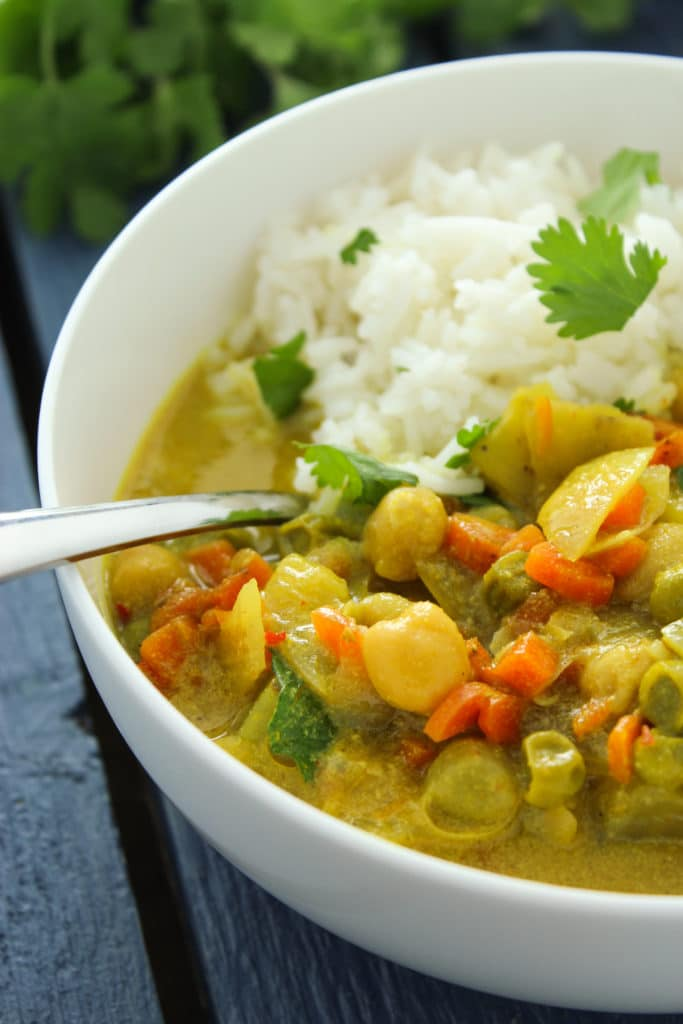 Crockpot Vegetable Curry In Bowl with Silver Spoon