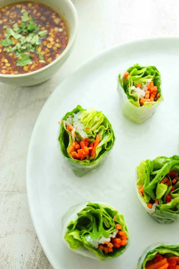 Vegan Summer Rolls on Plate with Creamy Peanut Dip and Chili Garlic Sauce