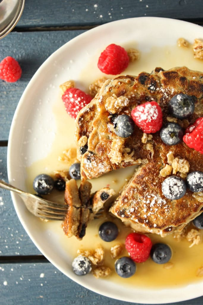 Blueberry Walnut Granola Pancakes on plate with fork
