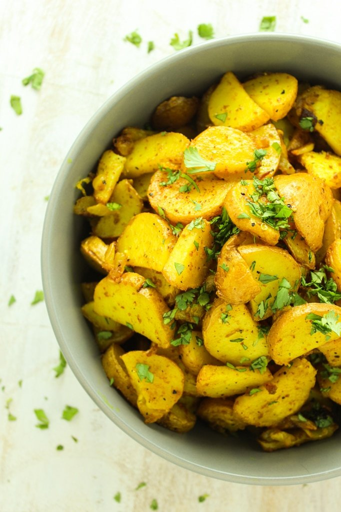 Crispy Turmeric Roasted Potatoes in bowl from above