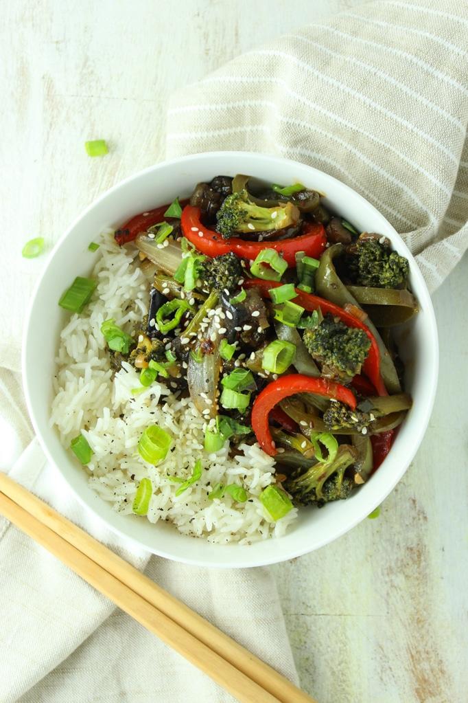Vegan Eggplant Stir Fry white bowl and chop sticks