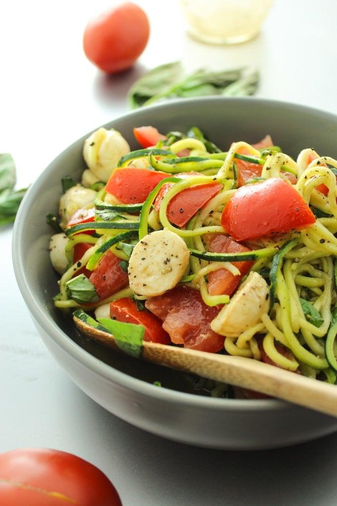 Zucchini Caprese Salad Close up Wooden Spoon