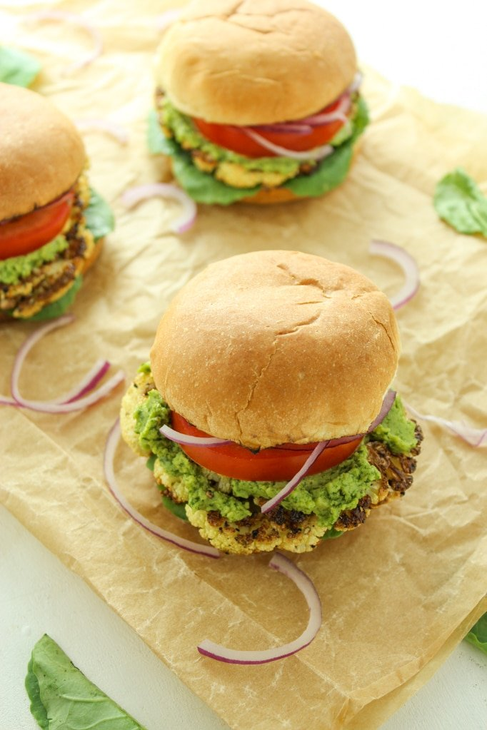 VEGAN sliders stuffed with cauliflower steaks! Seasoned simply with salt and pepper, roasted to golden brown perfection, topped with cashew pesto, and smooshed between mini buns. One of my all-time favorite things we've EVER made!
