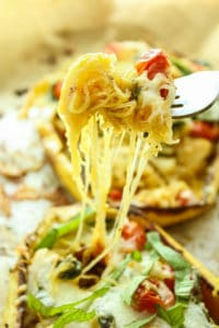 TWICE BAKED ITALIAN SPAGHETTI SQUASH – This is my comfort food go-to! It's so easy and stuffed with sautéed garlic, tomatoes, spinach, and melty, golden brown cheese.