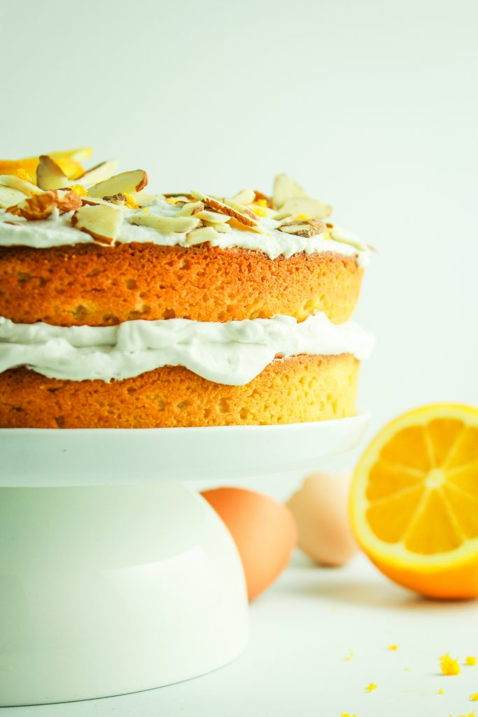 GLUTEN FREE ALMOND ORANGE CAKE – This almond cake recipe is flavored with fragrant freshly squeezed orange juice. It's luscious, moist, and decadent, and secretly so easy to create! It looks fancy enough for any special occasion or holiday gathering.