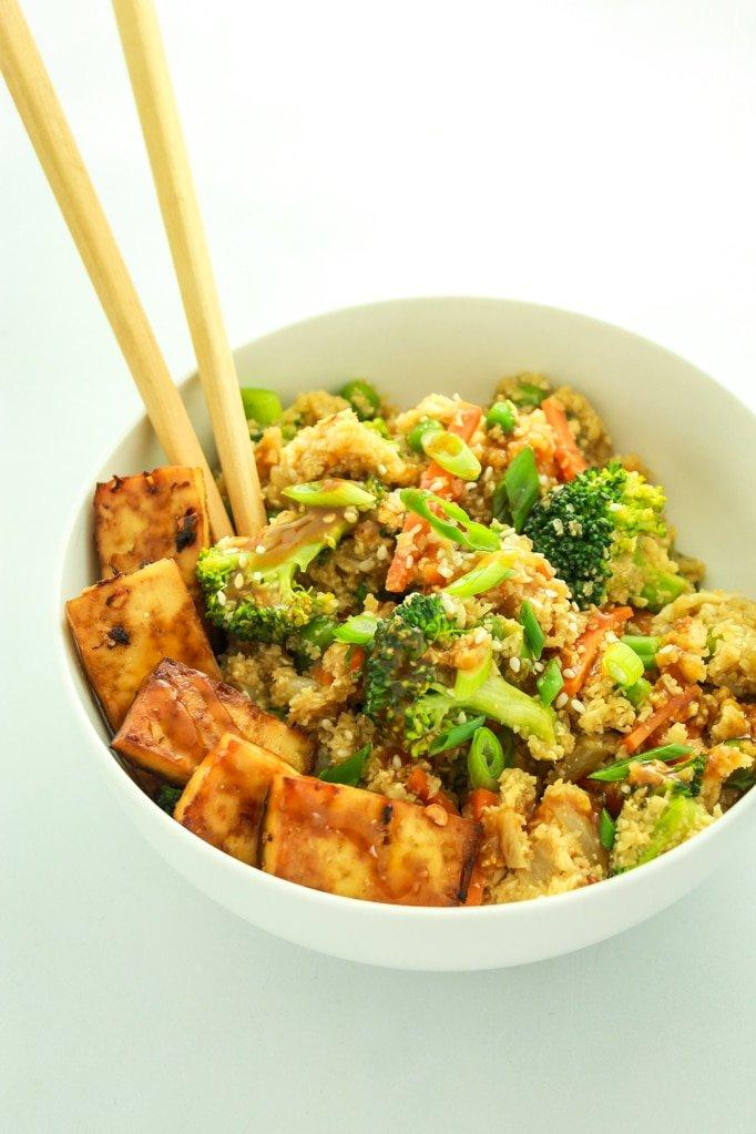 Cauliflower Rice Stir Fry with chop sticks in white bowl