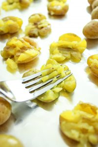 Garlic Smashed Potatoes – My new favorite side dish! It's crazy easy and takes less than 20 minutes. Use mini potatoes for a buttery texture!