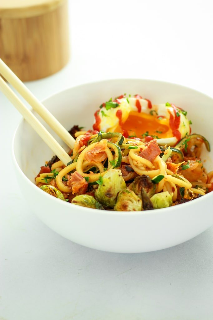Kimchi Zucchini Noodles in white bowl with chop sticks