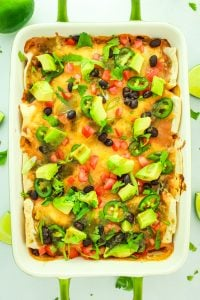 Green Chile Sweet Potato Enchiladas – BEST vegetarian enchilada recipe. Stuffed with sweet potatoes, black beans, and green chile goodness over top. Freezer friendly for meal prep!