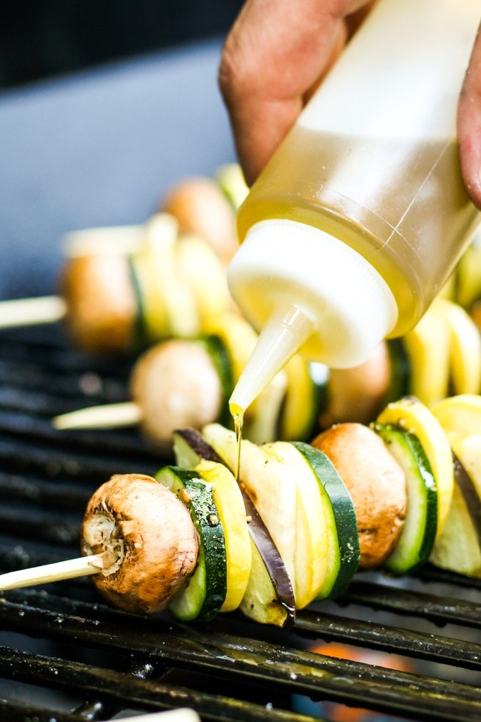 Oiling Ratatouille Kebabs on Grill