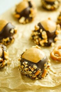 Peanut Butter Pretzel Buckeyes – These are our new favorite holiday candy! Gluten free so everyone gets to enjoy them. The crunchy pretzels are the best!