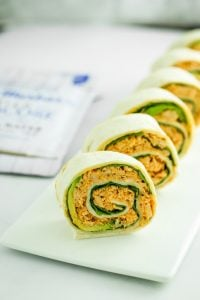Spicy Tuna Pinwheels – These spicy tuna pinwheels are the perfect bite-sized appetizer or snack. Ideal for tailgates and game day parties! Layer the wraps with spinach and avocado, then add the filling and roll!