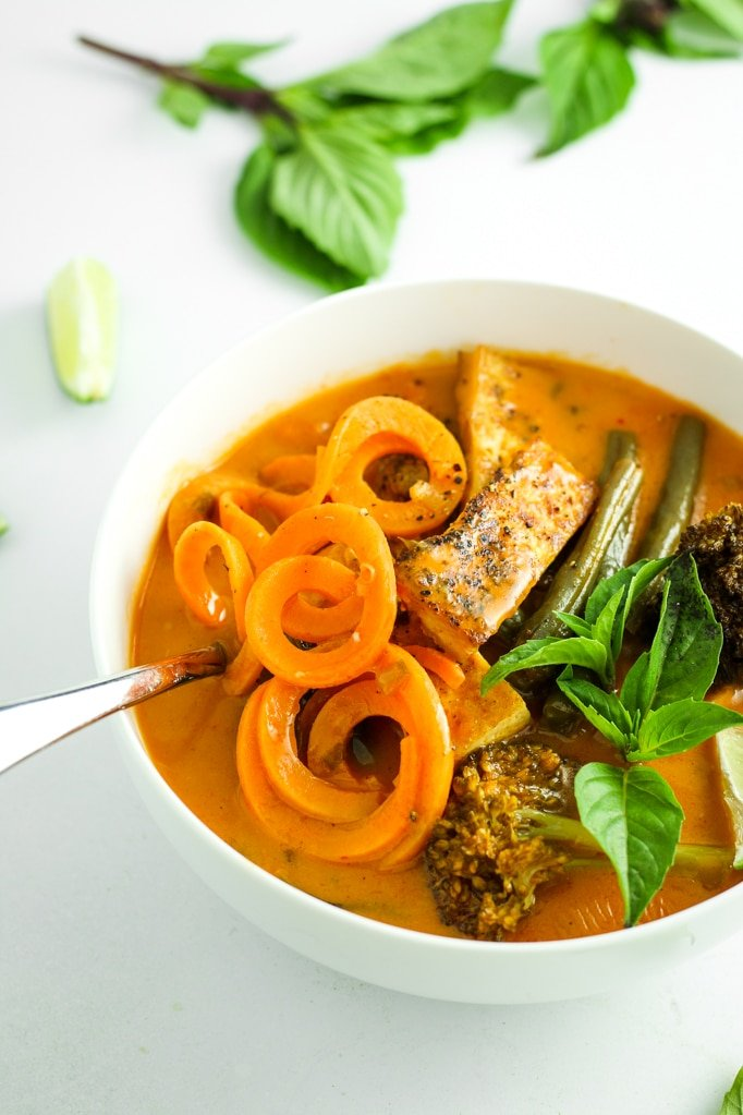 Sweet Potato Thai Red Curry in Bowl with Spoon Close up