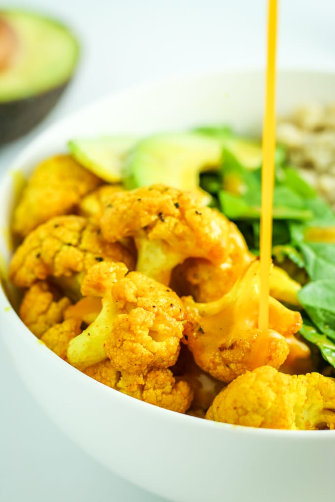 Turmeric Cauliflower Quinoa Meal Prep Bowls - EASY, filling, flavorful meal prep. Quinoa, crunchy chickpeas, greens, and cauliflower. I make this every other week!