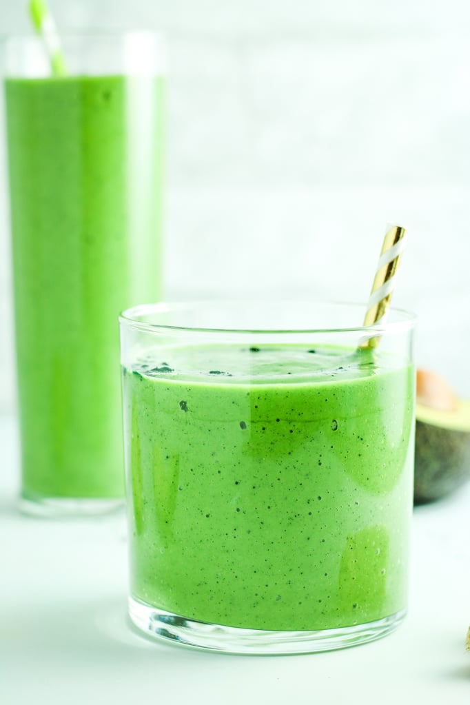 Avocado Spinach Green Smoothie in Glass with Straw