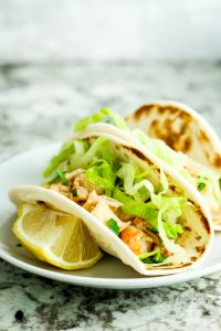 Lobster Roll Tacos - This lobster roll taco recipe is a perfect game day appetizer idea – especially for Patriots' fans! Load up street taco-style tortillas with the lobster mix and enjoy with friends.