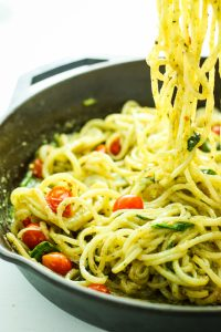 Creamy Pesto Potato Noodles - New FAVE vegan dinner recipe. The pesto sauce is CRAZY good. I could drink it. Made with spiralized potatoes!