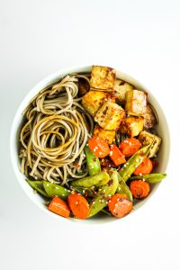 Sheet Pan Tofu Stir Fry - LOVE this recipe for easy dinner and meal prep. Tofu, snap peas, and carrots all on one pan. I like to serve over soba noodles or quinoa!