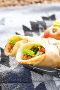 Mediterranean Chickpea Naan Wraps - ALL of the best flavors going on in these. Fresh, crunchy vegetables, hummus, and toasted chickpeas. JUST SO GOOD. Love these for a vegan picnic.