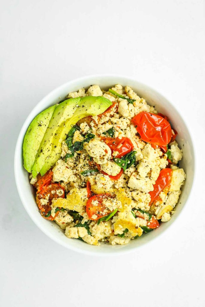 15 Minute Tofu Scramble - EASY healthy vegan breakfast idea. Tofu and veggies for protein and fiber. I make a batch ahead of time and reheat throughout the week.