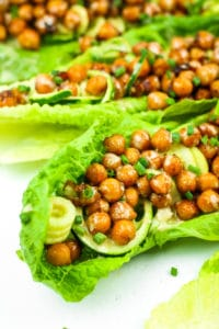 Sweet and Spicy Chickpea Lettuce Wraps - These are THE BEST vegan lettuce wraps. The chickpeas are sticky and caramelized - so good in the crunchy romaine. Great for meal prep!