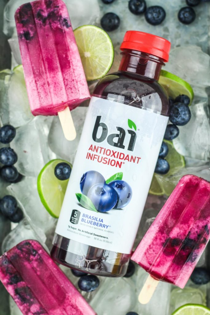 Blueberry Coconut Lime Popsicles - Easy vegan popsicle recipe that's perfect for summer! Popsicles with blueberry and lime! #vegan #popsicle #dessert #blueberry #ad @drinkbai