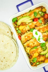 Vegetarian Breakfast Enchiladas - Brunch GOALS. These breakfast enchiladas are always a huge hit. We make them when we have breakfast for a crowd. They're also great for meal prepping.