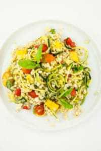 Zucchini and Corn Salad – The BEST summer salad. Couscous, zucchini, corn, tomatoes, feta, and a simple dressing. SO good and so simple.