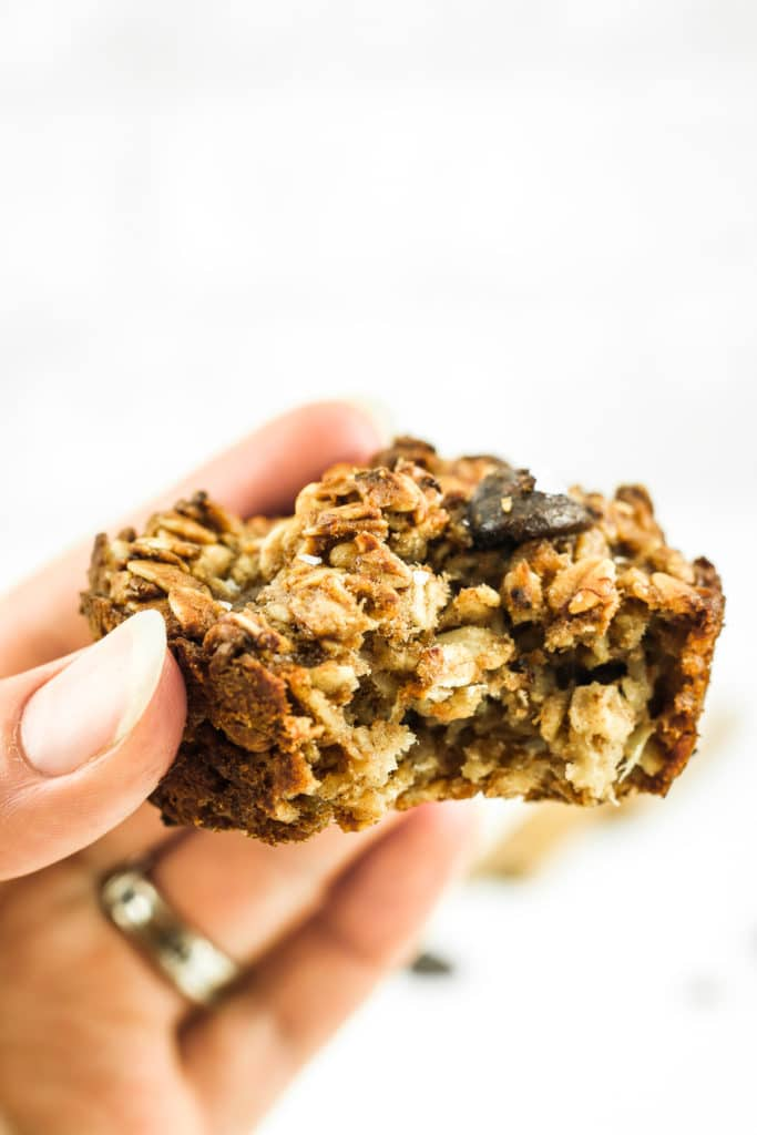 Hand Holding Chai Baked Oatmeal Muffin Close up