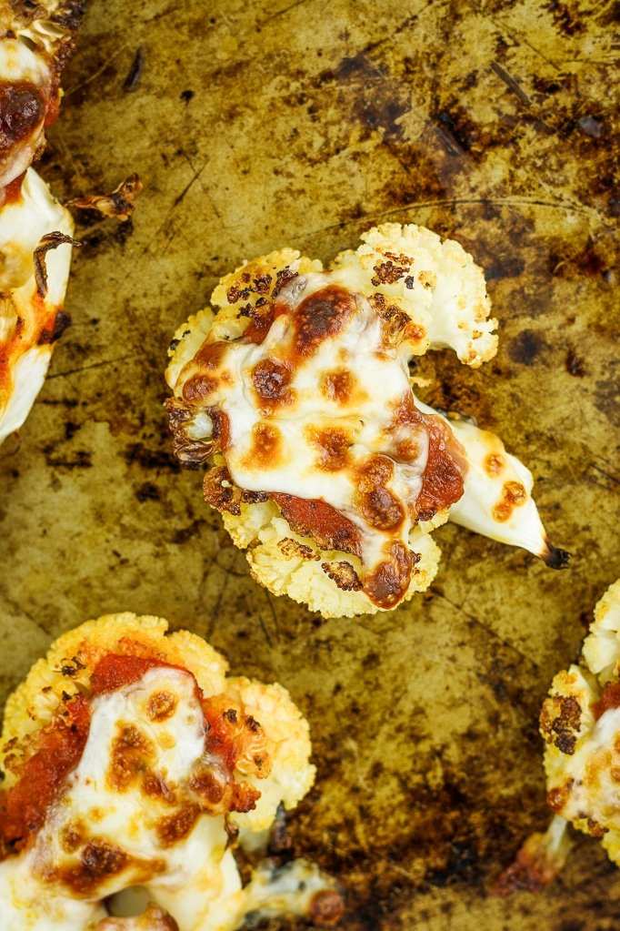 Cheesy Cauliflower Pizza Bites – These are the BOMB. So much easier than making cauliflower pizza crust and healthier than regular pizza dough. Gluten free and there's a vegan option.