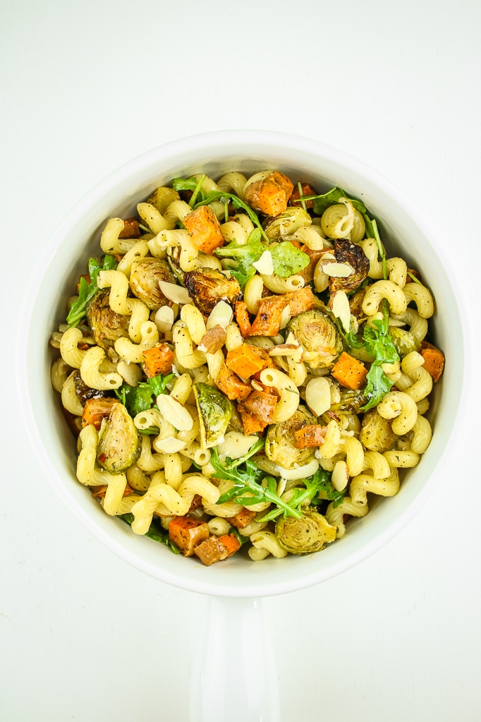 Vegan Fall Pasta Salad – Fall pasta salad with brussels sprouts AND sweet potatoes. This is our go-to for fall gatherings, Thanksgiving, holidays, and meal prep. It's an easy vegan side dish that everyone LOVES. #vegan #thanksgiving #healthy #sidedish