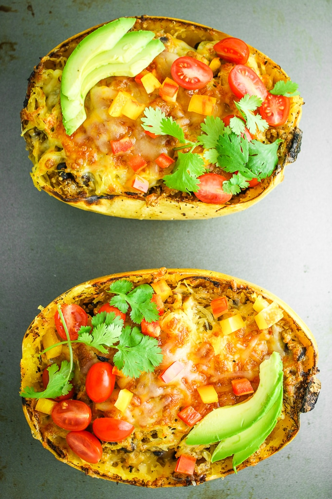 Quinoa Stuffed Spaghetti Squash – Stuffed spaghetti squash with quinoa and black beans! This is one of our favorite fall and winter dinner ideas. Spaghetti squash meal prep