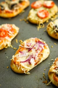 Tapas Pizzas – This tapas pizza recipe is made with Mahon-Mencora cheese, mini naan breads, and fresh veggies for a delicious bite-sized appetizer.