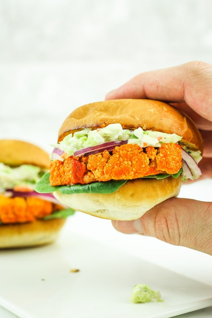 Buffalo Cauliflower Sliders with Blue Cheese Slaw - These vegetarian sliders are MIND BLOWING. So, so flavorful that even meat-lovers gobble them up! Perfect vegetarian game day recipe! #vegetarian #gameday #football #slider