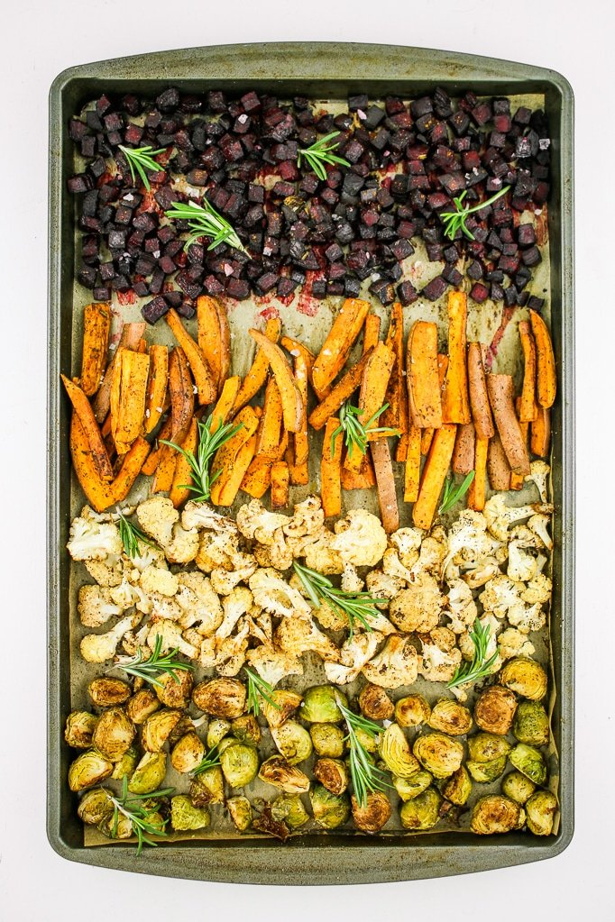 Rainbow Roasted Winter Vegetables - Sheet pan roasted winter vegetables. Sweet potatoes, beets, brussels sprouts, cauliflower, and rosemary! This is a great way to meal prep or make roasted veggie buddha bowls.
