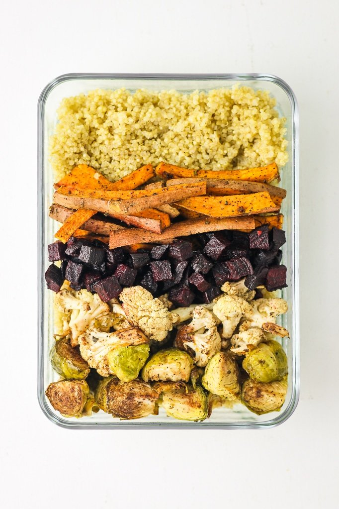 Roasted Vegetable Buddha Bowls – Sweet potatoes, brussels sprouts, cauliflower, and beets! These easy buddha bowls are perfect for lunch or meal prep. LOVE adding tahini! #vegan #buddhabowl #mealprep Easy vegan meal prep. Meal prep for beginners.