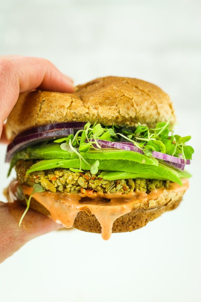Sunflower Seed Veggie Burgers – My FAVORITE veggie burger recipe ever. It's so easy, quick, and freezer friendly. Vegan and gluten free.