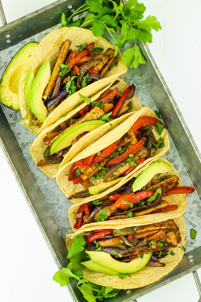 Sheet Pan Tofu Fajitas - This vegan meal prep recipe is one of my new favorites. Everything gets cooked on one sheet pan! Great with quinoa or rice, or in tortillas.