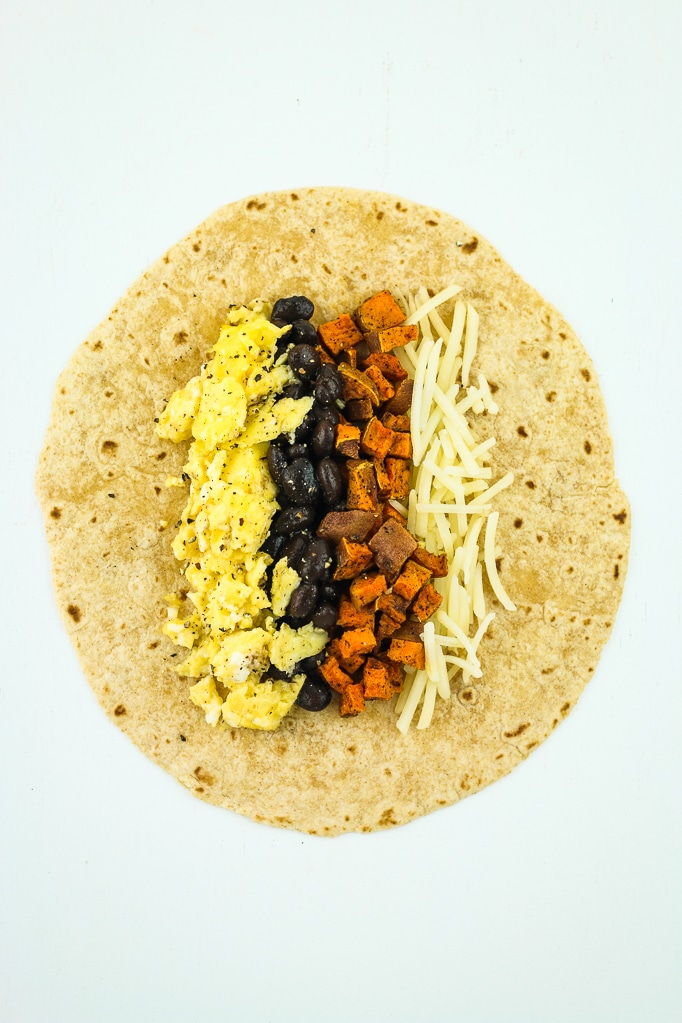 Breakfast burritos with sweet potatoes, black beans, and cheese.