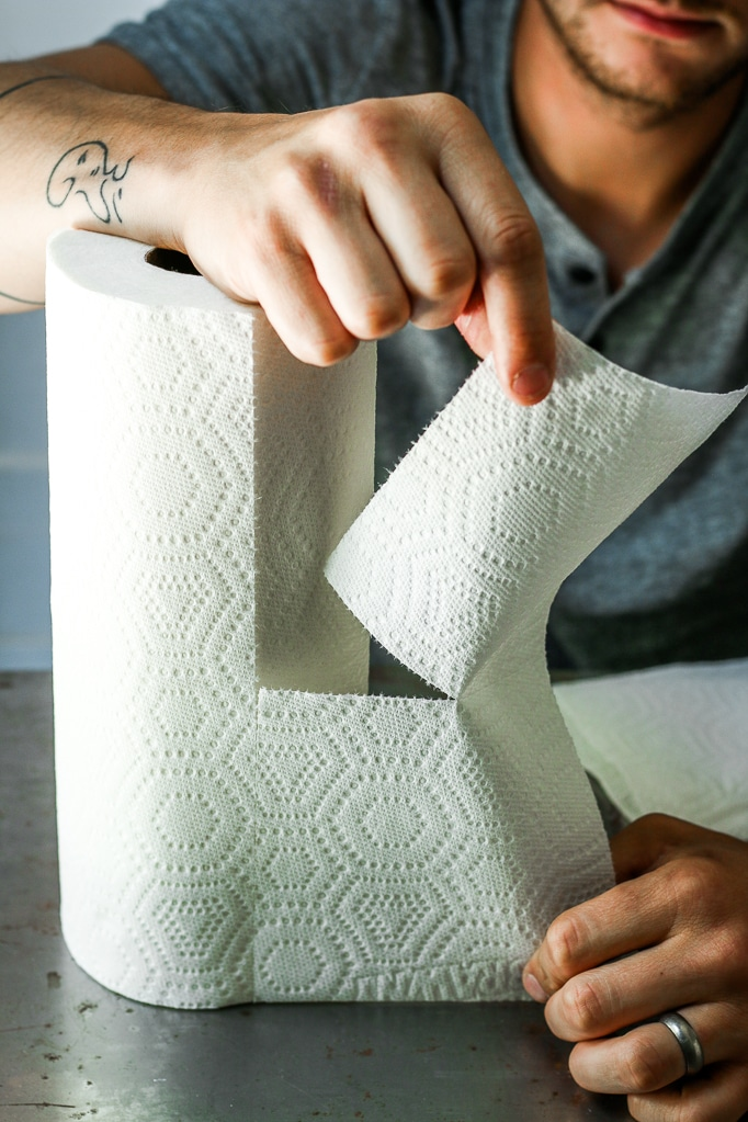 Hand Tearing Kitchen Roll